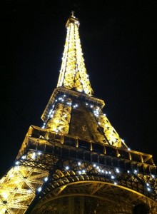 The Eiffel Tower is beautiful when it sparkles at nighttime.