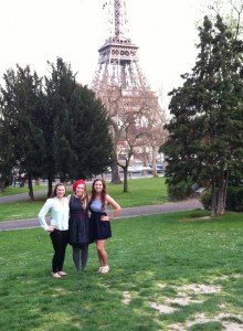 Three friends in front of the Eiffel Tower.